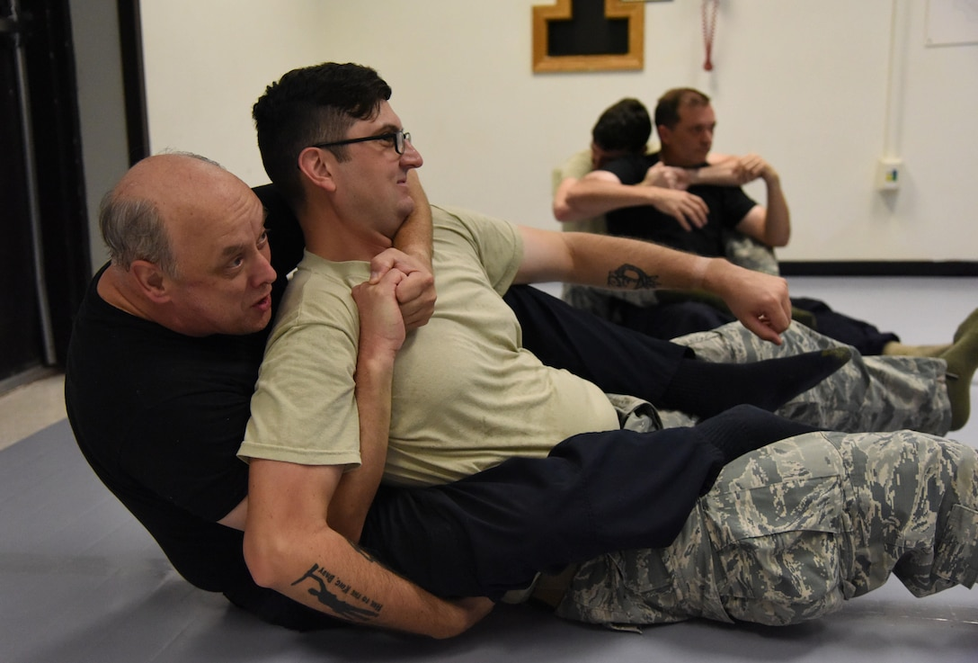 Officer Michael Brandau, 81st Security Forces Squadron patrolman, and Staff Sgt. Sean Miller, 81st SFS patrolman, practice a combative technique during an 81st SFS combative training course at the SFS building Oct. 19, 2017, on Keesler Air Force Base, Mississippi. Approximately 15-20 defenders were taught skills vital to surviving a hand-to-hand ground fight using mixed martial arts and Jiu Jitsu techniques as another tool to survive a confrontational environment. (U.S. Air Force photo by Kemberly Groue)