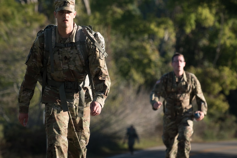 U.S. Army Soldiers ruck march during the German Armed Forces Proficiency Badge evaluation at Joint Base Langley-Eustis, Va., Oct. 19, 2017.