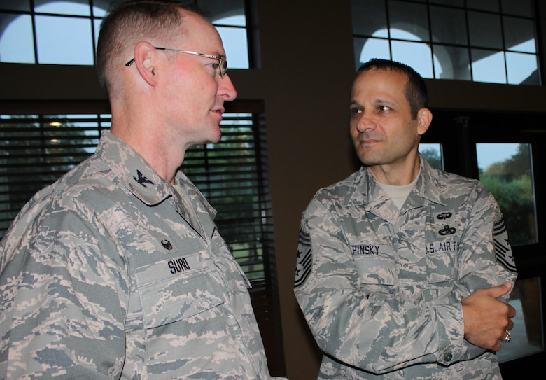 Col. Roger Suro, 340th Flying Training Group, chats with Chief Master Sgt. Brian Pinsky,