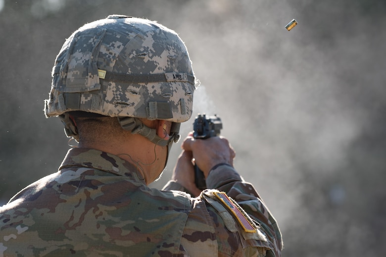 U.S. Army Sgt. Raquel Nunez-Hedrick, German Armed Forces Proficiency Badge competitor, dons her helmet before entering the shooting range at Joint Base Langley-Eustis, Va., Oct. 20, 2017.