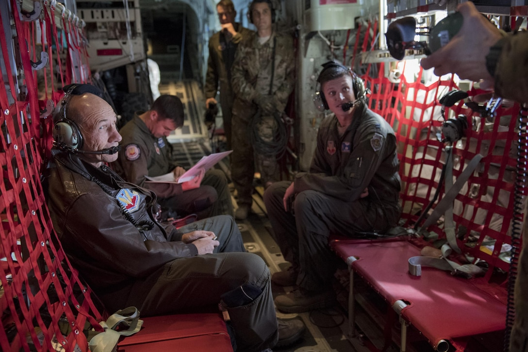Gen. Mike Holmes, commander of Air Combat Command, talks to Airmen over the communications system, Oct. 17, 2017, onboard an HC-130J Combat King II headed to Moody Air Force Base, Ga.