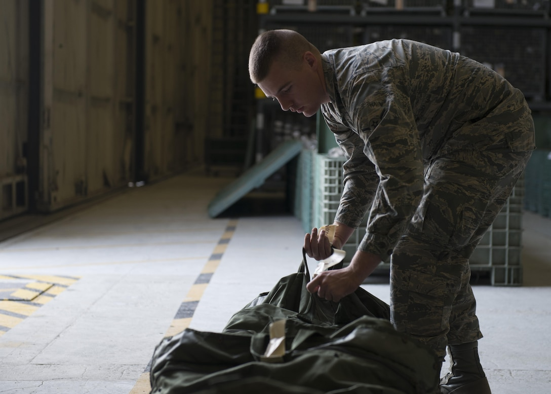 A 366th Logistics Readiness Squadron Airman checks a tag on a mobility bag for the Phase I exercise, Oct. 17, 2017, at Mountain Home Air Force Base, Idaho. The 366th LRS preformed the mobility bag checks for all aircrew participating in the exercise. (U.S. Air Force photo by Airman 1st Class JaNae Capuno)