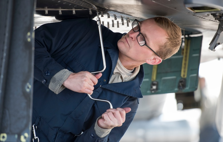 Airman 1st Class Cody Smith, 389th Aircraft Maintenance Unit aerospace propulsions, tightens down bolts on an aircraft, Oct. 18, 2017, at Mountain Home Air Force Base, Idaho. Units all across base participated in the Phase 1 exercise that tested the wing's ability to prepare for a deployment in a moments notice. (U.S. Air Force photo by Senior Airman Jeremy L. Mosier)