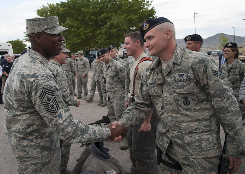 U.S. Air Force Chief Master Sergeant of the Air Force Kaleth O. Wright greets members of the 377th Security Forces Group at Kirtland Air Force Base, N.M., Oct. 20.