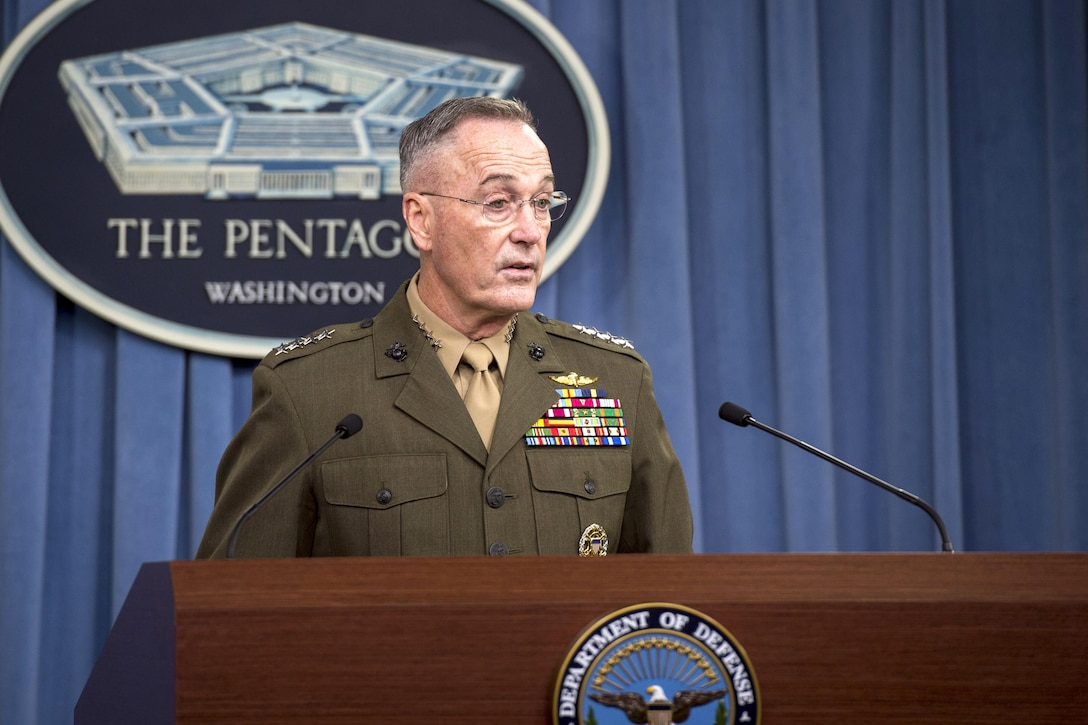 The chairman of the Joint Chiefs of Staff speaks from behind a podium.