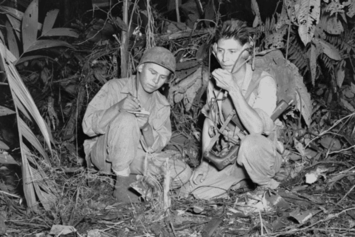 Navajo code talkers use radios to communicate in 1943.