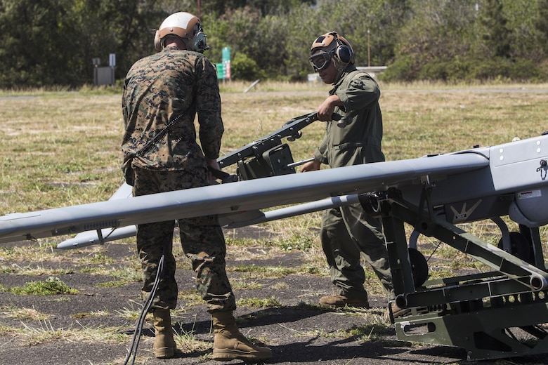 U.S. Marines with Marine Unmanned Aerial Vehicle Squadron 3, start the engine of an RQ-7B Shadow unmanned aerial system during a training event at Landing Zone Westfield, Marine Corps Air Station Kaneohe Bay, Oct. 18, 2017. The purpose of the event is to conduct UAS operations with a minimal amount of personnel and equipment after flying a system in by KC-130J in order to operate immediately within a short amount of time. (U.S. Marine Corps photo by Lance Cpl. Isabelo Tabanguil)