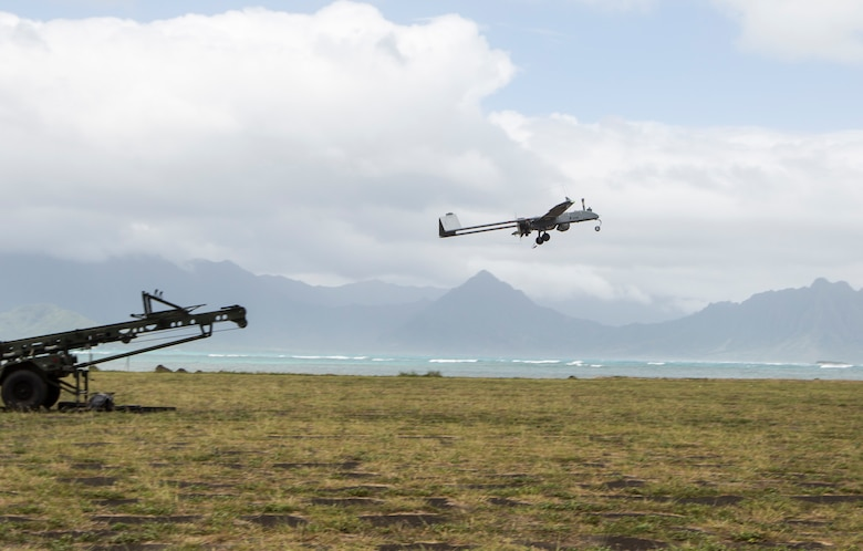 An RQ-7B Shadow unmanned aerial system with Marine Unmanned Aerial Vehicle Squadron 3 (VMU-3), is launched during a training event at Landing Zone Westfield, Marine Corps Air Station Kaneohe Bay, Oct. 13, 2017. The purpose of the event is to conduct UAS operations with a minimal amount of personnel and equipment after flying a system in by KC-130J in order to operate immediately within a short amount of time. (U.S. Marine Corps photo by Lance Cpl. Isabelo Tabanguil)