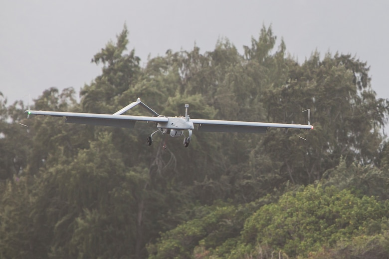 An RQ-7B Shadow unmanned aerial system with Marine Unmanned Aerial Vehicle Squadron 3 (VMU-3) , conducts a landing approach during a training event at Landing Zone Westfield, Marine Corps Air Station Kaneohe Bay, Oct. 18, 2017. The purpose of the event is to conduct UAS operations with a minimal amount of personnel and equipment after flying a system in by KC-130J in order to operate immediately within a short amount of time. (U.S. Marine Corps photo by Lance Cpl. Isabelo Tabanguil)