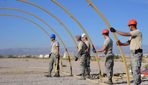 99th Civil Engineer Squadron structural engineers build a field tent during a base emergency engineer force training exercise at Nellis Air Force Base, Nevada, Oct. 19, 2017. Field tents provide shelter and storage for personnel and equipment in deployed locations. (U.S. Air Force photo by Airman 1st Class Andrew D. Sarver/Released)