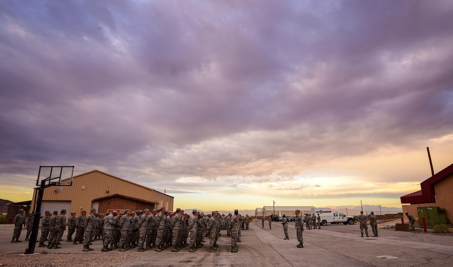 Airmen from the 99th Civil Engineer Squadron fall into formation to kick off their monthly base emergency engineer force training exercise at Nellis Air Force Base, Nevada, Oct. 19, 2017. The training consisted of bare base setup and airfield management. (U.S. Air Force photo by Airman 1st Class Andrew D. Sarver/Released)