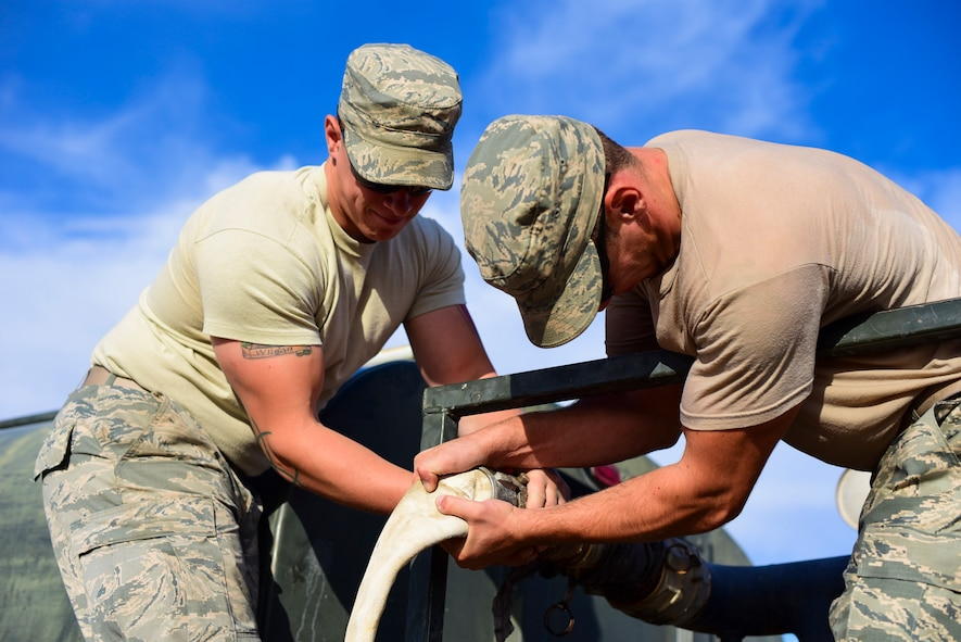 Pavement and construction equipment Airmen from the 99th Civil Engineer Squadron replace a water hose at Nellis Air Force Base, Nevada, Oct. 19, 2017. The 99th CES conducted their monthly base emergency engineer force training exercise to practice bare base setup and airfield repair. (U.S. Air Force photo by Airman 1st Class Andrew D. Sarver/Released)