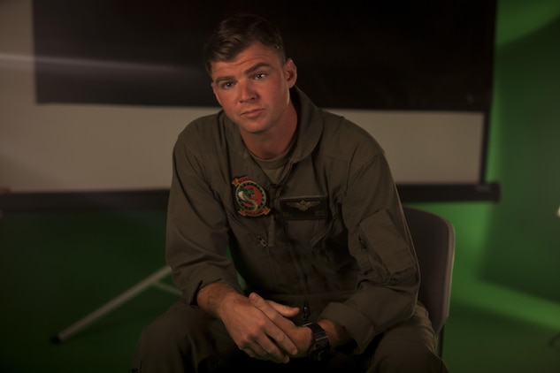 A Marine pilot poses for a portrait photo.