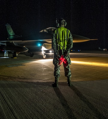 U.S. Air Force Airmen First Class Tyler Keiser marshals an F-16 Fighting Falcon at Kunsan Air Base, Republic of Korea, July. 27, 2017.  The F-16 went through final checks before flight. (U.S. Air Force photo by Senior Airman. Coleville Mcfee)