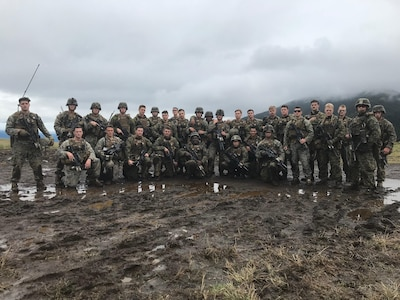 Marines posing for a photo after finishing the live fire platoon attack range.