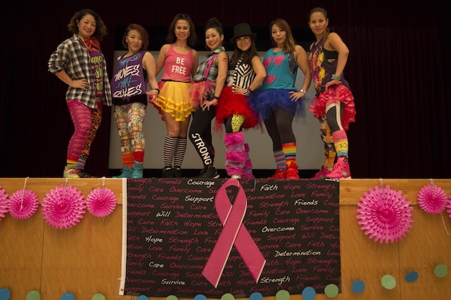 CAMP FOSTER, OKINAWA, Japan – Zumba instructors pose during the Breast Cancer Awareness Zumbathon Oct. 20 in the Community Center aboard Camp Foster, Okinawa, Japan.