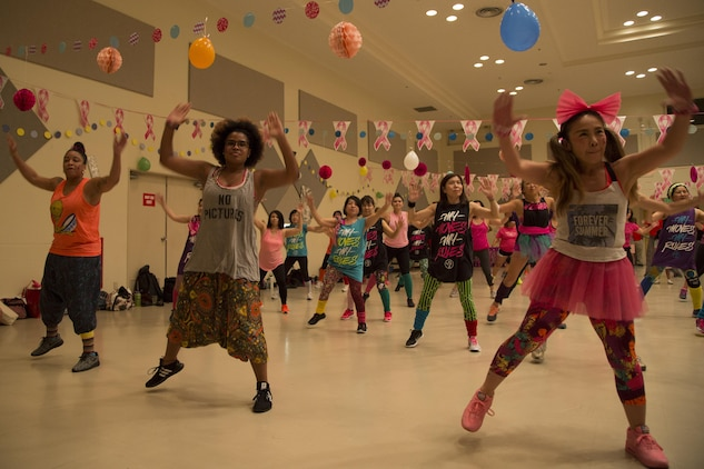 CAMP FOSTER, OKINAWA, Japan – The military and local communities come together for two hours of Zumba to help spread awareness at the Breast Cancer Awareness Zumbathon Oct. 20 at the Community Center aboard Camp Foster, Okinawa, Japan.