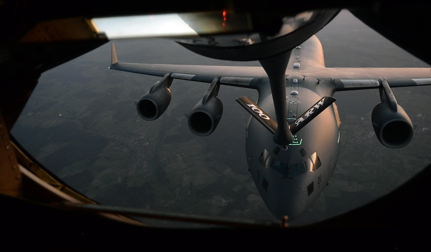 A C-17 Globemaster III flies behind a U.S. Air Force KC-135 during an aerial-refueling training exercise over Germany, Oct. 19, 2017. The C-17 operates out of Papa Air Base, Hungary, by the Heavy Airlift Wing which is made up of personnel from 12 countries. (U.S. Air Force photo by Airman 1st Class Luke Milano)