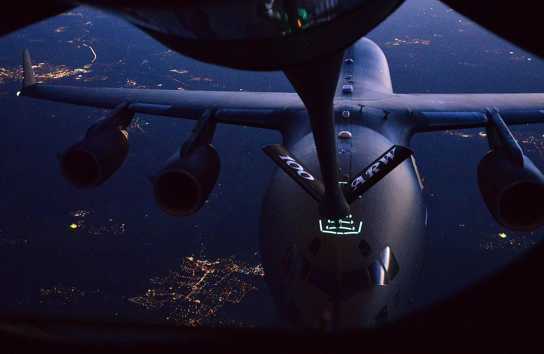 A U.S. Air Force KC-135 performs a dry contact with a C-17 Globemaster III during an aerial-refueling training exercise over Germany, Oct. 19, 2017. The training exercise was done in support of the Strategic Airlift Command operated out of Papa Air Base, Hungary. Strategic Airlift Command consists of 12 NATO and Partnership for Peace nations. (U.S. Air Force photo by Airman 1st Class Luke Milano)