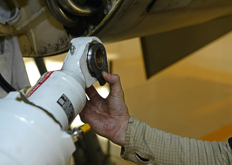 A 31st Maintenance Squadron Airman replaces the left shock strut on an F-16 Fighting Falcon Oct. 18, 2017, at Aviano Air Base, Italy. This routine maintenance inspection occurs every six years and the process takes approximately five work days to accomplish. (U.S. Air Force photo by Airman 1st Class Ryan Brooks)