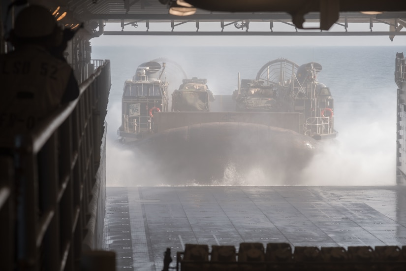 171018-N-OW019-097 U.S 5TH FLEET AREA OF OPERATIONS (Oct. 16, 2017) A landing craft, air cushion (LCAC), operated by Sailors of Assault Craft Unit 5, exits the well deck of the amphibious dock landing ship USS Pearl Harbor (LSD 52) as it prepares to go ashore in support of Iron Magic 18. Iron Magic 18 is a combined-arms live-fire engagement meant to expand levels of cooperation, enhance mutual maritime capabilities, and promote long-term regional stability and interoperability between U.S. forces and regional partners. (U.S. Navy photo by Mass Communication Specialist Seaman Logan C. Kellums/Released)