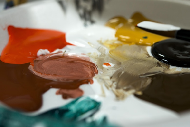 Paint rests on a palette during a Painting with a Twist event, Oct. 21, 2017, at Moody Air Force Base, Ga. The event was geared toward providing fun painting experiences for Active Duty members and their dependents, which can help ease some of the stress they face as military families. During the event, participants went through the steps to paint a festive fall pumpkin.  (U.S. Air Force photo by Airman 1st Class Erick Requadt)
