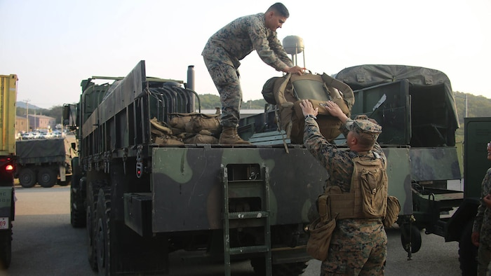Marines with Marine Air Support Squadron 2, Marine Air Control Group 18, Marine Aircraft Group 36, 1st Marine Aircraft Wing, offload gear