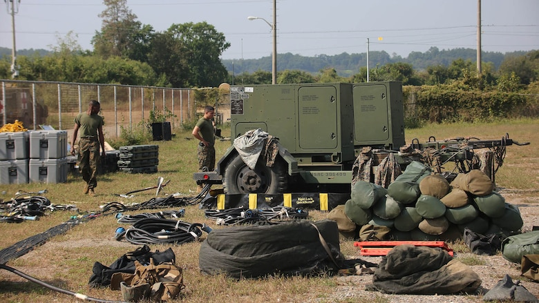 Marines with Marine Air Support Squadron 2, Marine Air Control Group 18, Marine Aircraft Group 36, 1st Marine Aircraft Wing, set up gear