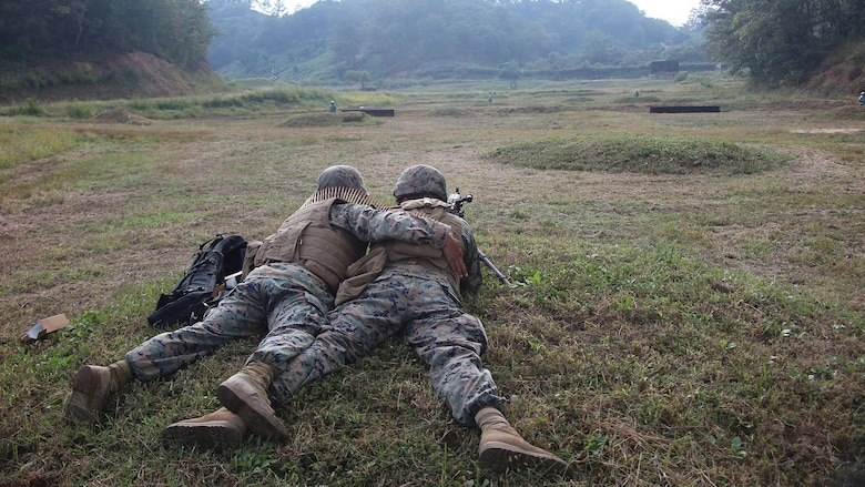 Marines with Marine Air Support Squadron 2, Marine Air Control Group 18, Marine Aircraft Group 36, 1st Marine Aircraft Wing, conduct a range.