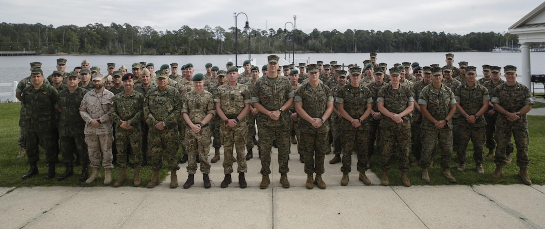 Coalition partners pose for a group photo during a cookout at Camp Lejeune, N.C., Oct. 17, 2017. Bold Alligator 17 is a large-scale, multinational amphibious exercise designed to execute complex shaping operations, amphibious landing and attack, and sea basing operations to improve U.S. and coalition ship-to-shore capabilities. (U.S. Marine Corps photo by Lance Cpl. Leynard Kyle Plazo)