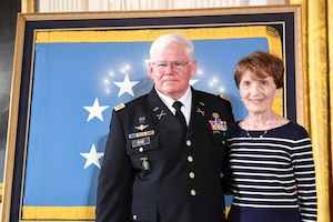 Retired Army Capt. Gary M. Rose and his wife, Margaret, prepare to attend a Medal of Honor ceremony at the White House.