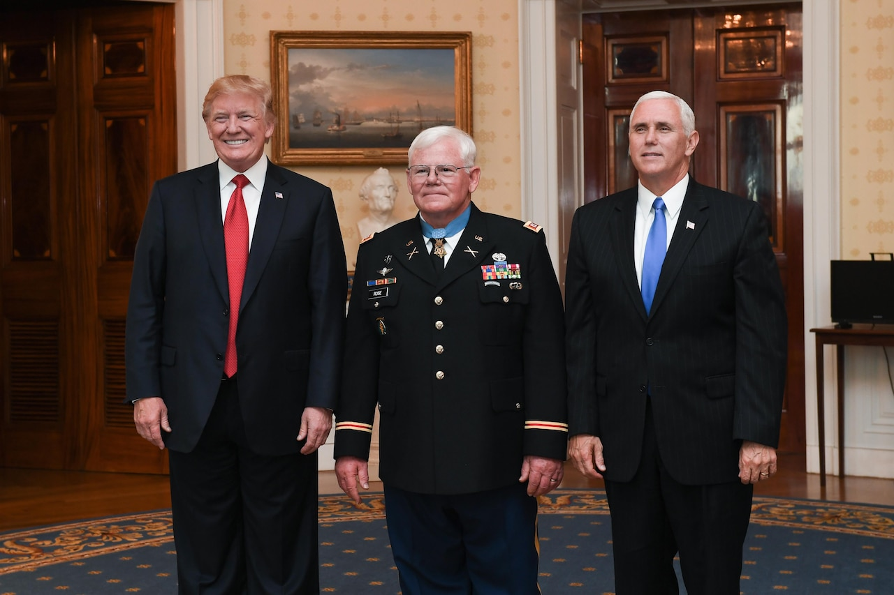 President Donald J. Trump, retired Army Capt. Gary M. Rose and Vice President Mike R. Pence pose for a photo.