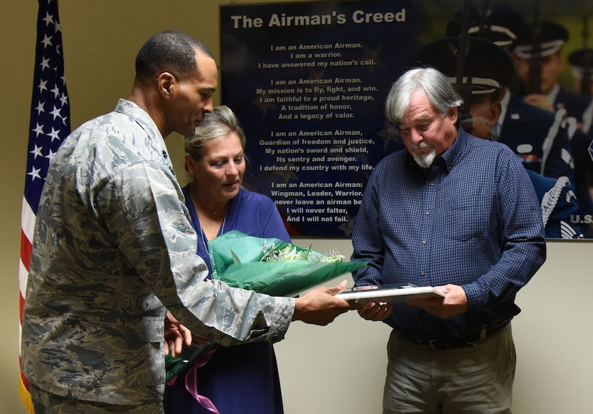 Lt. Col. Billy Wilson, 334th Training Squadron commander, presents Suzi Fernandez and Brent Sibley with plaques during a dedication ceremony to honor their son, Staff Sgt. Forrest Sibley, at Cody Hall Oct. 20, 2017, on Keesler Air Force Base, Mississippi. Sibley was killed in combat in Afghanistan on Aug. 26, 2015. Sibley, a four-time Bronze Star medal recipient, was a combat controller who received his initial technical training from the 334th Training Squadron here. A training room was dedicated in his memory during the event. (U.S. Air Force photo by Kemberly Groue)