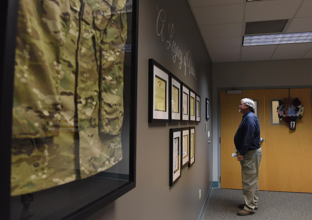 Brent Sibley admires memorabilia during a dedication ceremony to honor his son, Staff Sgt. Forrest Sibley, at Cody Hall Oct. 20, 2017, on Keesler Air Force Base, Mississippi. Sibley was killed in combat in Afghanistan on Aug. 26, 2015. Sibley, a four-time Bronze Star medal recipient, was a combat controller who received his initial technical training from the 334th Training Squadron here. (U.S. Air Force photo by Kemberly Groue)
