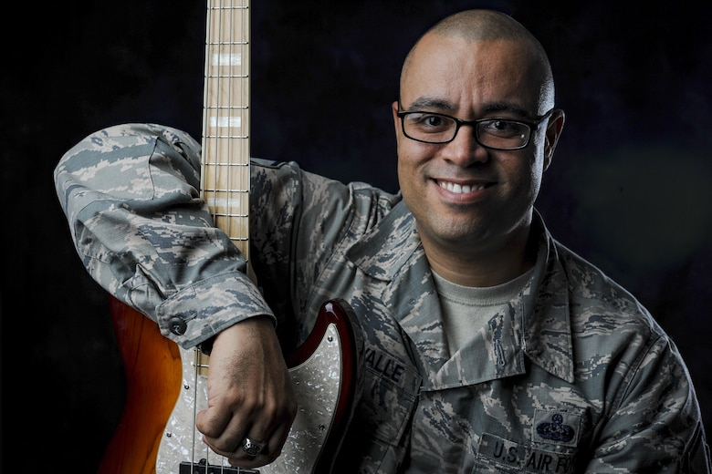 U.S. Air Force Master Sgt. John Del Valle, 693rd Intelligence Support Squadron operations section chief, is an avid jazz enthusiast and spends his after duty hours mastering the bass guitar. Del Valle toured with the Air Force Tops in Blue in 2006 which reignited his passion for music. (U.S. Air Force photo by Senior Airman Devin Boyer)