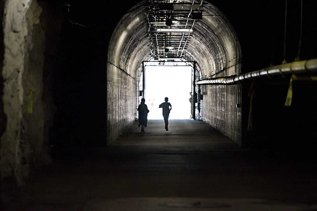 Runners enter the south portal of Cheyenne Mountain Air Force Station, Colorado, during the Zombie Tunnel 5k Fun Run, Oct. 20, 2017. The run gave Front Range military members and their families an opportunity to have an inside look at Cheyenne Mountain AFS. (U.S. Air Force photo by Steve Kotecki)