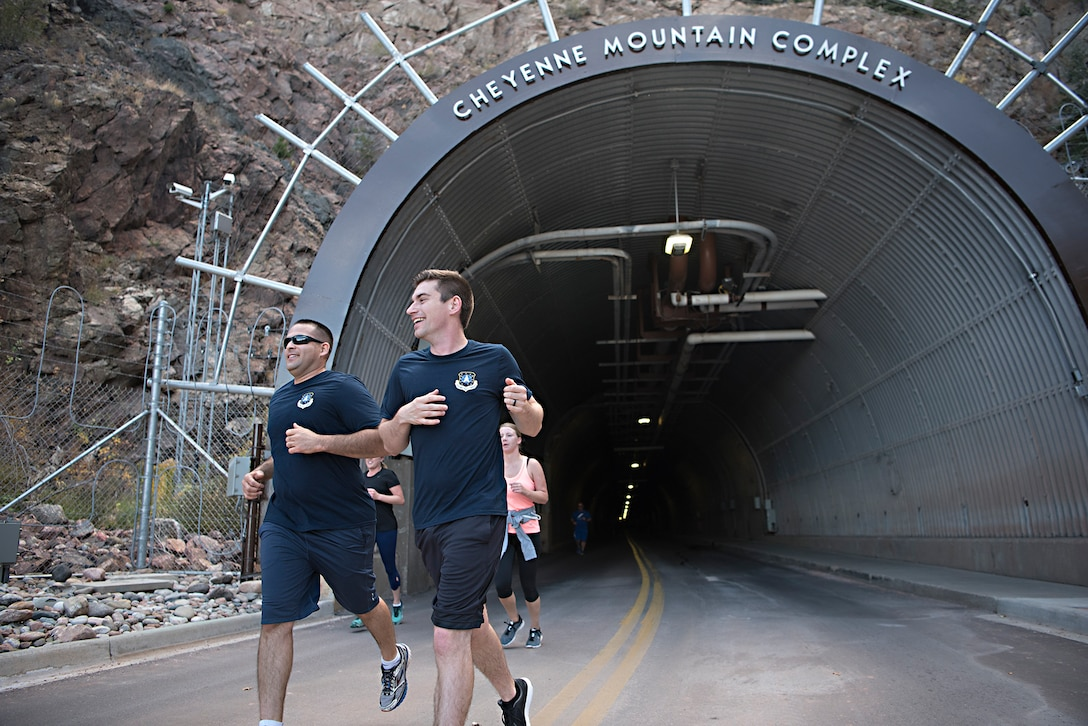 Runners exit the north portal of Cheyenne Mountain Air Force Station, Colorado, during the Zombie Tunnel 5k Fun Run, Oct. 20, 2017. The run gave participants the opportunity to run the full length of the Cheyenne Mountain AFS tunnel. (U.S. Air Force photo by Steve Kotecki)