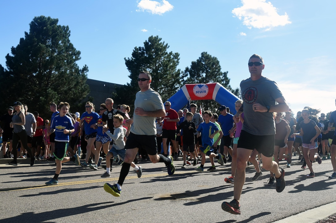 Participants embark at the start of the Zombie Tunnel 5k Fun Run at Cheyenne Mountain Air Force Station, Colorado, Oct. 20, 2017. The run wound around Cheyenne Mountain, with zombies awaiting runners along the way. (U.S. Air Force photo by Airman 1st Class William Tracy)