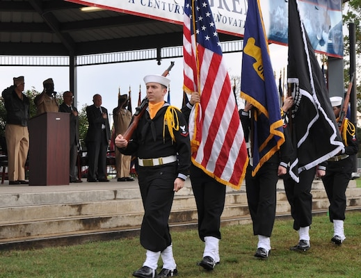 IMAGE: DAHLGREN, Va. (Oct. 16, 2017) – The Aegis Training and Readiness Center Ceremonial Color Guard marches in front of military and civilian personnel gathered with visitors to commemorate the centennial of the Navy base at Dahlgren with a kickoff ceremony. Over the next 12 months, personnel at the base and its tenant commands will join the community to engage in activities such as a science, technology, engineering and mathematics event, a time capsule ceremony, triathlon, spring picnic, concert lunch, historic movie premier, rocket contest, and a grand finale – all in celebration of the centennial.