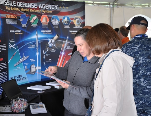 IMAGE: DAHLGREN, Va. (Oct. 16, 2017) – Military and civilian personnel learn more about the Aegis Ballistic Missile Defense (BMD) command in the exhibit tent while celebrating the centennial of the Navy base at Dahlgren. Aegis BMD is both the Navy element of the Missile Defense Agency, as well as a field activity of the Naval Sea Systems Command. It builds upon and extends capabilities inherent in the Aegis Weapon System, Standard Missile, and Navy command and control systems. Aegis BMD ships provide the Combatant Commanders with significant flexibility to meet changing operational demands.