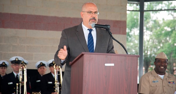 """IMAGE: DAHLGREN, Va. (Oct. 16, 2017) – Naval Surface Warfare Center Dahlgren Division Technical Director John Fiore reviews the century of innovation at Dahlgren before the military and civilian audience gathered to celebrate the Navy base's centennial. """"Today we kick off the Dahlgren Centennial countdown,"""" said Fiore.  """"It has the potential to fill us with wonderment. What will be the groundbreaking new innovations of the Navy's future and who will be there to make that happen? I look forward to the events that are scheduled throughout this year in celebrating our centennial but even more important than what we've done in the past is where we're going to go in the future and the contributions we will make to the Navy moving forward."""""""