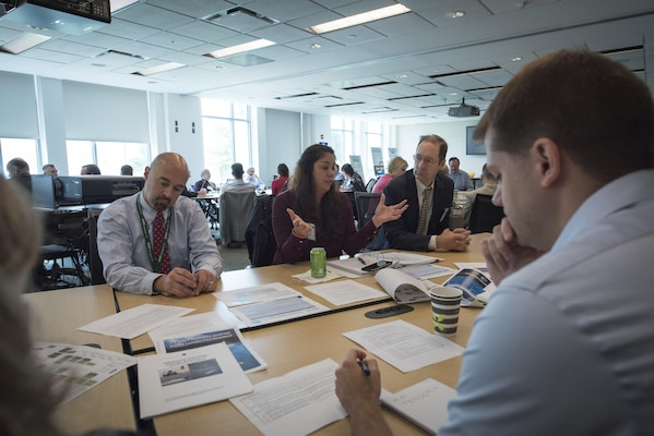 Jen McKee (center) from Naval Surface Warfare Center, Indian Head Explosive Ordnance Disposal Technology Division and other employees from across the Department of the Navy interested in unmanned systems discuss potential test ranges and facilities during the Deputy Assistant Secretary of the Navy for Unmanned Systems Facilities Roadmap workshop at Naval Surface Warfare Center, Carderock Division's West Bethesda, Maryland, headquarters Sept. 19-20, 2017. (U.S. Navy photo by Monica McCoy/Released)