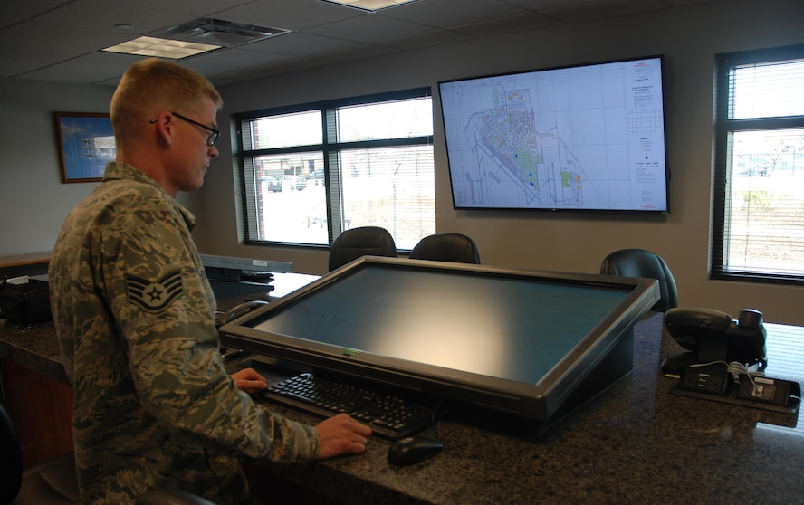 Staff Sgt. Jason Turton, 21st Operations Support Squadron Airfield Management Operations supervisor, demonstrates how the Peterson Air Force Base Flight Planning Room works Oct. 19, 2017 at Peterson Air Force Base, Colorado. He created and implemented the room allowing crews to more efficiently plan flights using 42-inch screens and computers instead of digital tablets and paper forms. (U.S. Air Force photo by Dave Smith)
