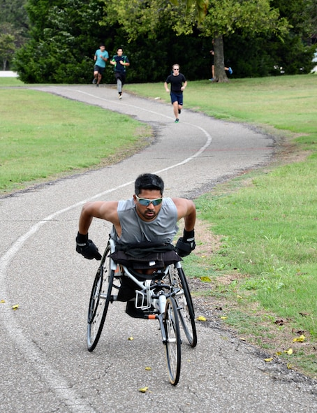 David Satre, with the Air Force Life Cycle Management Center, glides to the finish line in the National Disability Employment Awareness Month Fun Run/Walk held Oct. 5