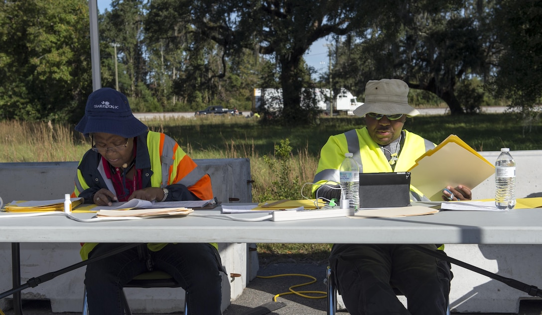 Eleanor Van Cleve and Joseph Alem, Federal Emergency Management Agency transportation managers, review paperwork of inbound cargo Oct. 21.