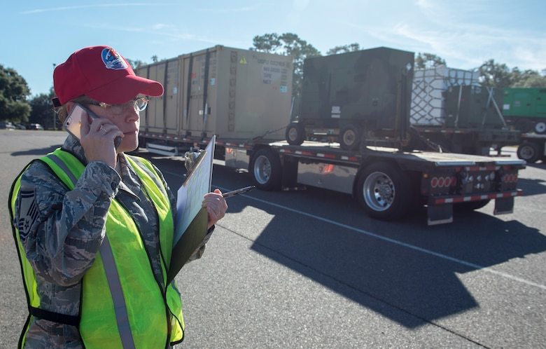 U.S. Air Force Senior Master Sgt. Samantha Davis, 203rd Red Horse material manager, verifies the location of equipment headed to Joint Base Charleston Oct. 20.