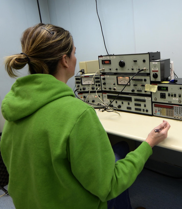 Elizabeth Maschmeyer, 3rd Maintenance Squadron Precision Measurement Equipment Laboratory calibration technician, calibrates a sound system at Joint Base Elmendorf-Richardson, Alaska, Oct. 23, 2017. Technicians from the 3rd MXS PMEL can calibrate and repair Test Measurement and Diagnostic Equipment to accuracies ranging from millionths of an inch to microvolts, depending upon the measurement area. They do so with four criteria in mind: accuracy, reliability, traceability and safety. (U.S. Air Force photo/Senior Airman Curt Beach)