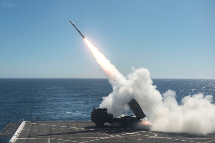 The High Mobility Artillery Rocket System (HIMARS) is fired from the flight deck of the amphibious transport dock ship USS Anchorage (LPD 23) during Dawn Blitz 2017 over the Pacific Ocean, Oct. 22, 2017. Dawn Blitz is a scenario-driven exercise designed to train and integrate Navy and Marine Corps units by providing a robust training environment where forces plan and execute an amphibious assault, engage in live-fire events, and establish expeditionary advanced bases in a land and maritime threat environment to improve naval amphibious core competencies. (U.S. Navy photo by Mass Communication Specialist 2nd Class Matthew Dickinson)