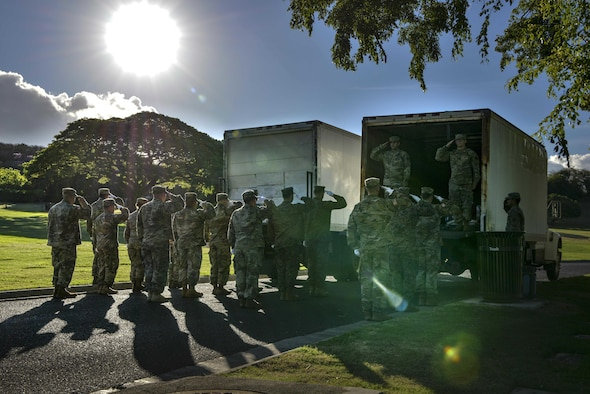 Servicemembers with the Defense POW/MIA Accounting Agency honor the fallen during a disinterment ceremony Aug. 28, 2017, at the National Memorial Cemetery of the Pacific in Honolulu, Hawaii. The remains disinterred will be transferred to the DPAA laboratory for identification. (U.S. Air Force photo by Senior Airman Mikaley Kline)