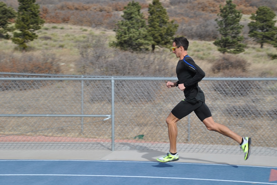 Maj. Benjamin Payne works out on the U.S. Air Force Academy track on Dec. 10, 2015. Payne is among the runners selected to represent the Air Force in the Conseil International du Sport Militaire World Military Cross Country Championship Nov. 3-7, 2017, in Balatonakarattya, Hungary. (U.S. Air Force photo by Carole Chiles Fuller)